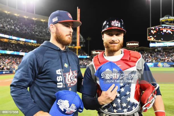 Sam Dyson and Jonathan Lucroy of team United States celebrate together after their 80 win over team Puerto Rico during Game 3 of the Championship...