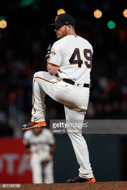 Sam Dyson of the San Francisco Giants pitches against the Colorado Rockies during the eighth inning at ATT Park on June 26 2017 in San Francisco...