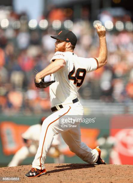 Sam Dyson of the San Francisco Giants pitches against the Milwaukee Brewers in the ninth inning at ATT Park on August 23 2017 in San Francisco...