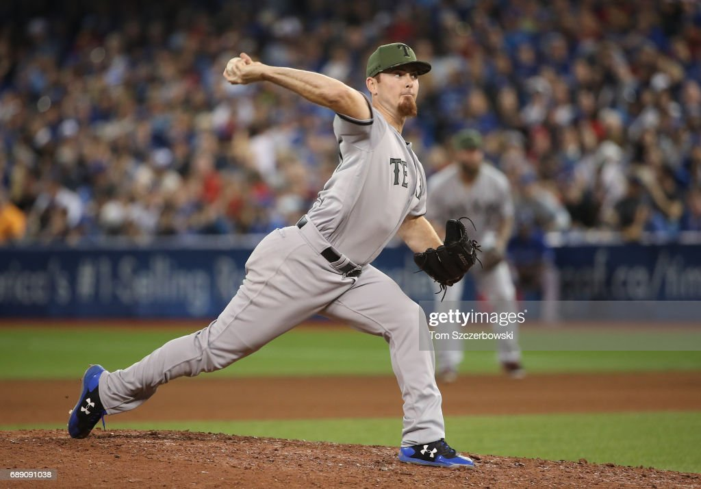 Sam Dyson #47 of the Texas Rangers delivers a pitch in the seventh inning during MLB game action against the Toronto Blue Jays at Rogers Centre on May 27, 2017 in Toronto, Canada.