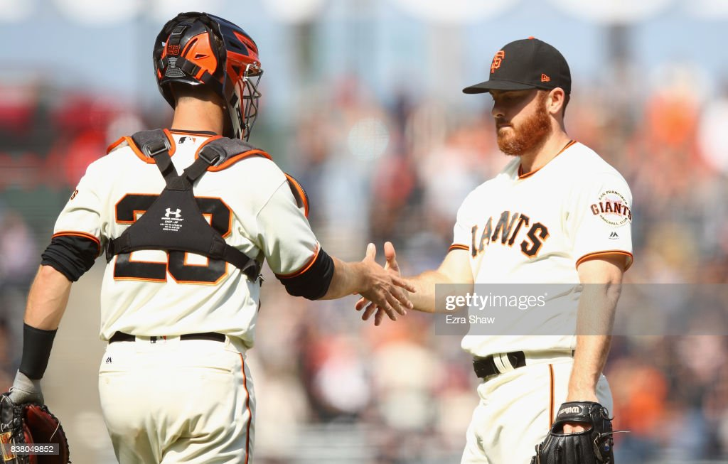 Sam Dyson #49 shakes hands with Buster Posey #28 of the San Francisco Giants after they beat the Milwaukee Brewers at AT&T Park on August 23, 2017 in San Francisco, California.