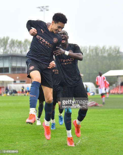 Sam Edozie of Manchester City celebrates as scores their fourth goal during the U18 Premier League match between Stoke City and Manchester City at...