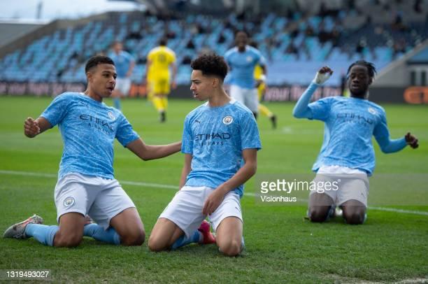 Sam Edozie of Manchester City celebrates scoring their team's first goal with team mates Shea Charles, Darko Gyabi and Romeo Lavia during the U18...