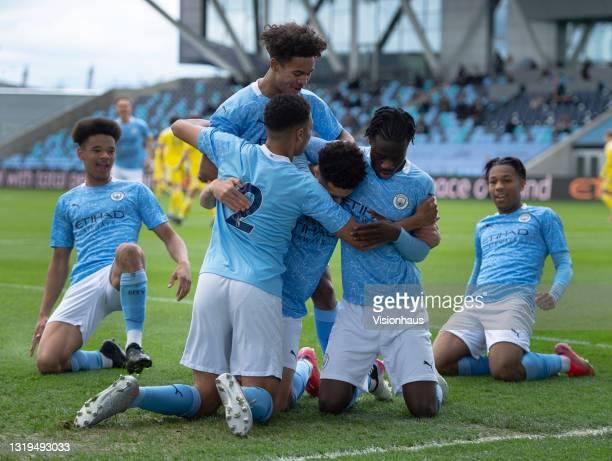 Sam Edozie of Manchester City celebrates scoring their team's first goal with team mates Shea Charles, Darko Gyabi, Jadel Katongo, Oscar Bobb and...