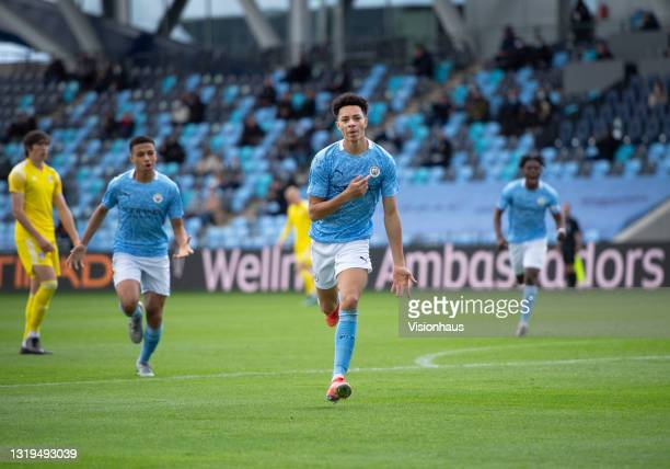 Sam Edozie of Manchester City celebrates scoring their team's first goal with team mates Shea Charles and Romeo Lavia during the U18 Premier League...