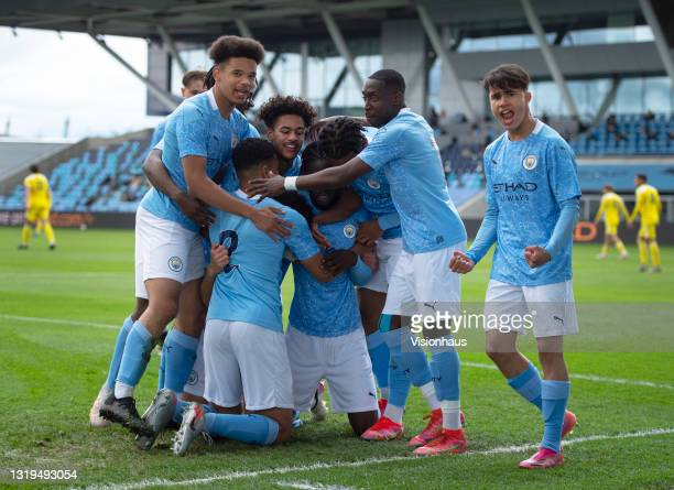 Sam Edozie of Manchester City celebrates scoring their team's first goal with team mates Shea Charles, Darko Gyabi, Jadel Katongo, Romeo Lavia,...