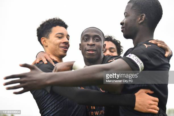 Sam Edozie of Manchester City celebrates with his teammates as as scores their fourth goal during the U18 Premier League match between Stoke City and...