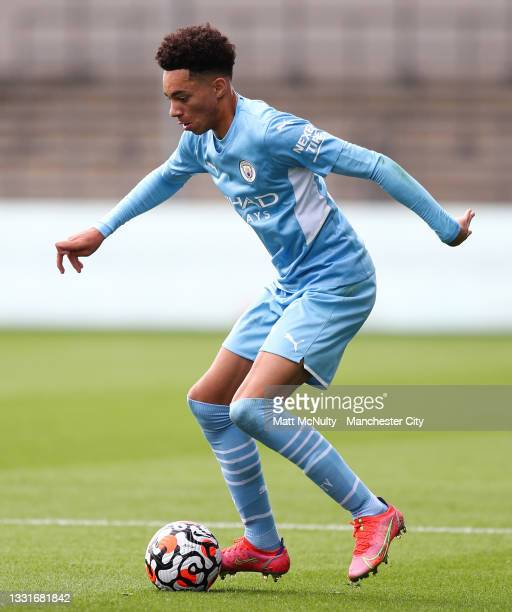 Sam Edozie of Manchester City in action during the pre-season friendly match between Manchester CIty and Barnsley at Manchester City Football Academy...