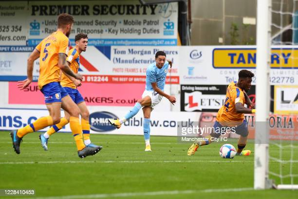 Sam Edozie of Manchester City shoots during the EFL Trophy match between Mansfield Town and Manchester City U21 at One Call Stadium on September 8,...
