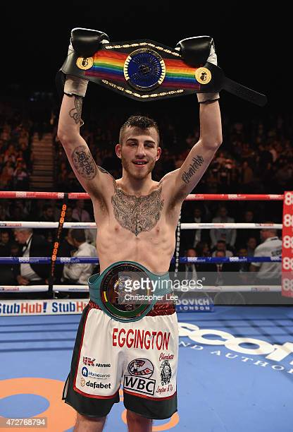 Sam Eggington poses for the camera with his belts after his victory over Oseph Lamptey after the referee stops it during the Vacant Commonwealth...
