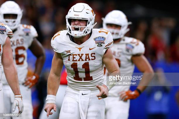 Sam Ehlinger of the Texas Longhorns celebrates a touchdown during the second half of the Allstate Sugar Bowl against the Georgia Bulldogs at the...