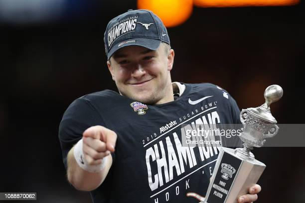 Sam Ehlinger of the Texas Longhorns celebrates after defeating the Georgia Bulldogs 2821 during the Allstate Sugar Bowl at MercedesBenz Superdome on...