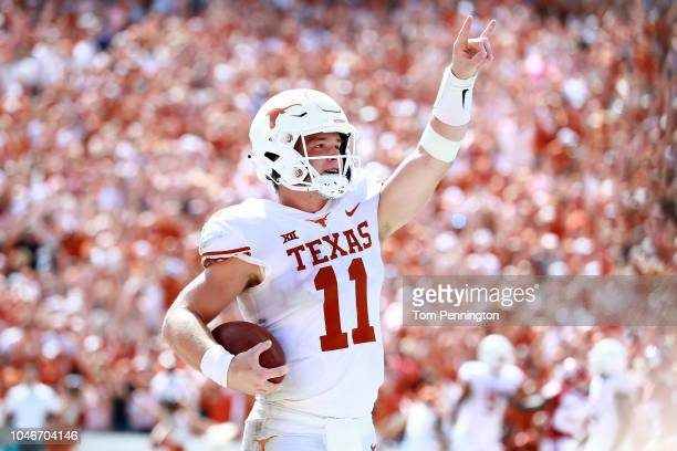 Sam Ehlinger of the Texas Longhorns celebrates after scoring a touchdown against the Oklahoma Sooners in the third quarter of the 2018 ATT Red River...