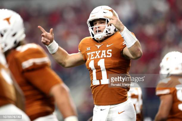 Sam Ehlinger of the Texas Longhorns celebrates his touchdown run against the Oklahoma Sooners in the first quarter at ATT Stadium on December 01 2018...