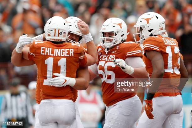 Sam Ehlinger of the Texas Longhorns is congratulated after a touchdown by Zach Shackelford in the first quarter against the Texas Tech Red Raiders at...