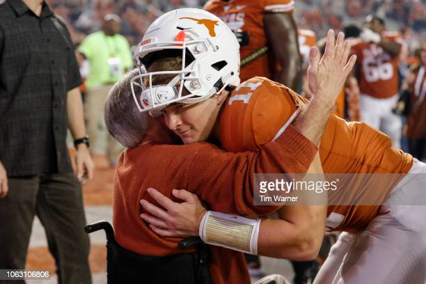 Sam Ehlinger of the Texas Longhorns is greeted by Texas Governor Greg Abbott after the game against the Iowa State Cyclones at Darrell K RoyalTexas...