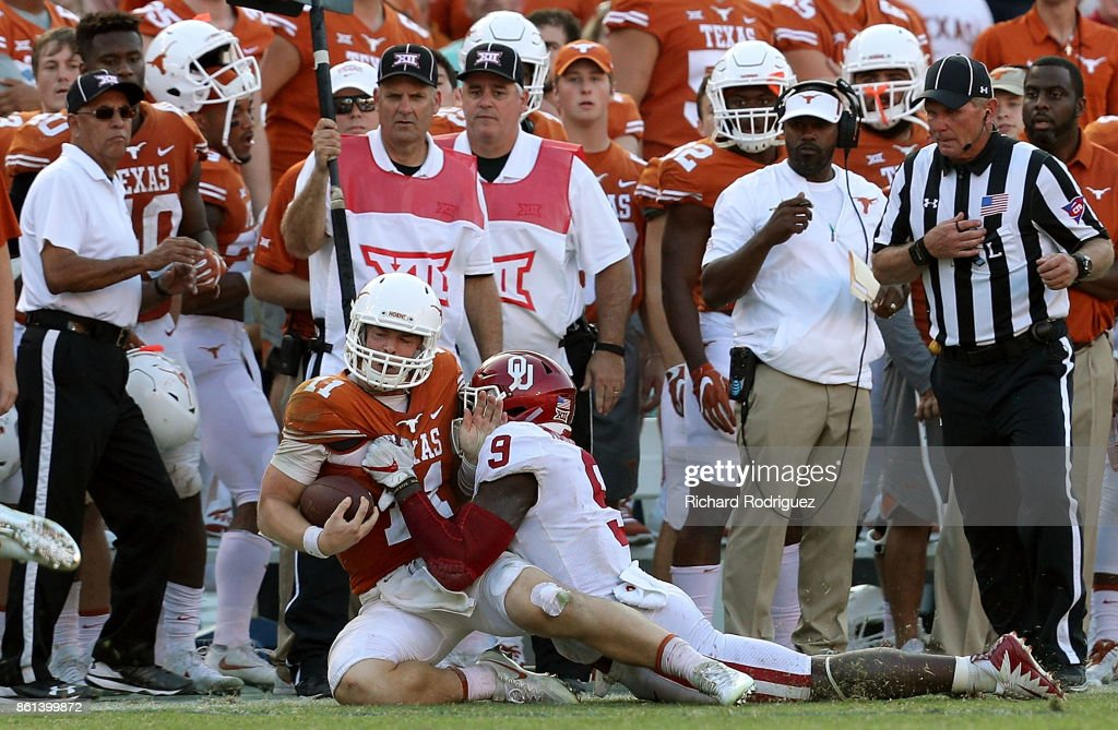 Sam Ehlinger #11 of the Texas Longhorns is tackled by Kenneth Murray #9 of the Oklahoma Sooners near the Texas sideline in the fourth quarter at Cotton Bowl on October 14, 2017 in Dallas, Texas. Oklahoma beat Texas 29-24.