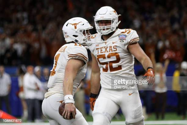 Sam Ehlinger of the Texas Longhorns reacts after scoring a touchdown against the Georgia Bulldogs at the MercedesBenz Superdome on January 01 2019 in...