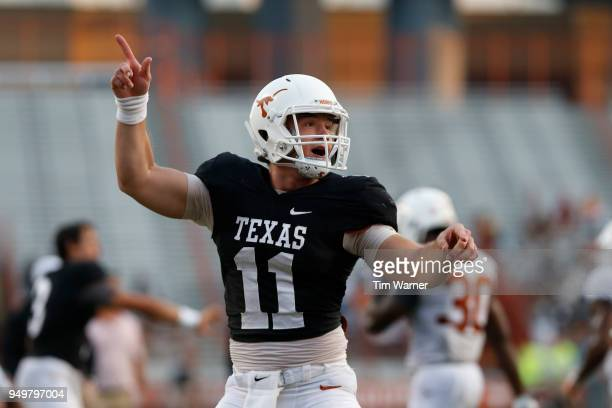 Sam Ehlinger of the Texas Longhorns reacts in the first half after a touchdown during the OrangeWhite Spring Game at Darrell K RoyalTexas Memorial...
