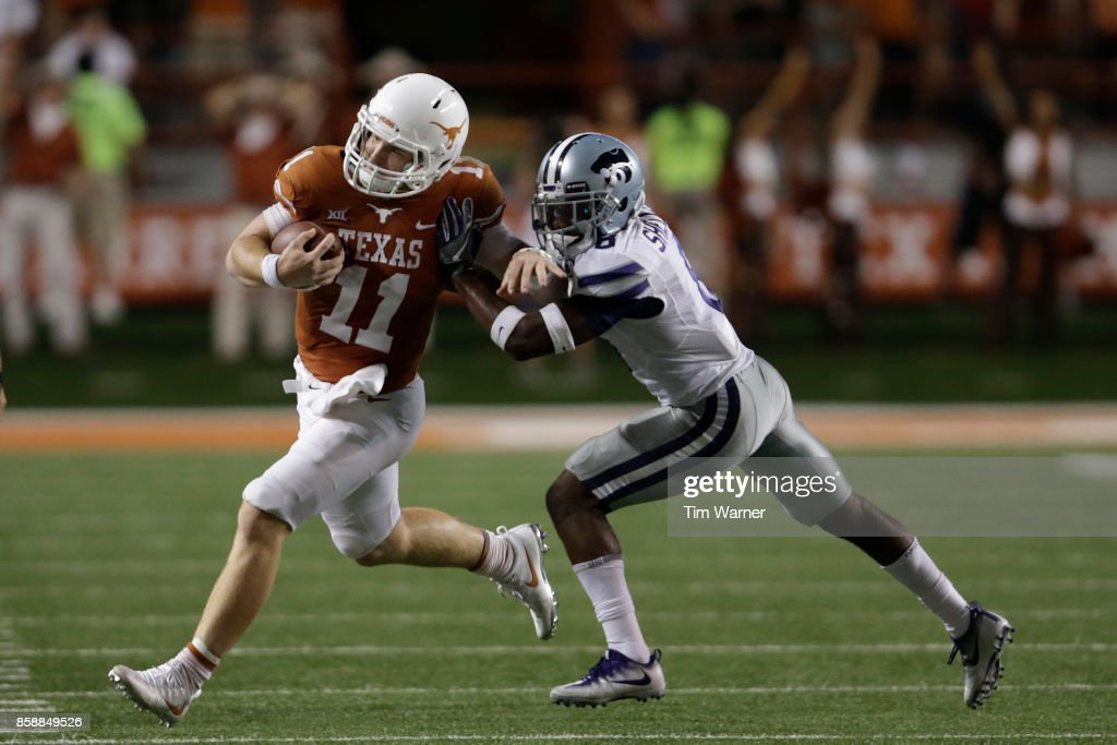 Sam Ehlinger #11 of the Texas Longhorns runs the ball pursued by Duke Shelley #8 of the Kansas State Wildcats in the fourth quarter at Darrell K Royal-Texas Memorial Stadium on October 7, 2017 in Austin, Texas.