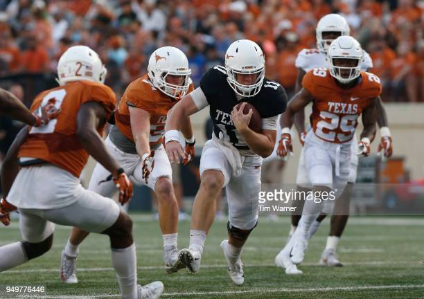 Sam Ehlinger of the Texas Longhorns scrambles for a first down in the first half pursued by Kyle Hrncir and Josh Thompson during the OrangeWhite...