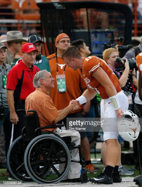 Sam Ehlinger of the Texas Longhorns shakes hands with Texas Governor Greg Abbott before the game against the USC Trojans at Darrell K RoyalTexas...