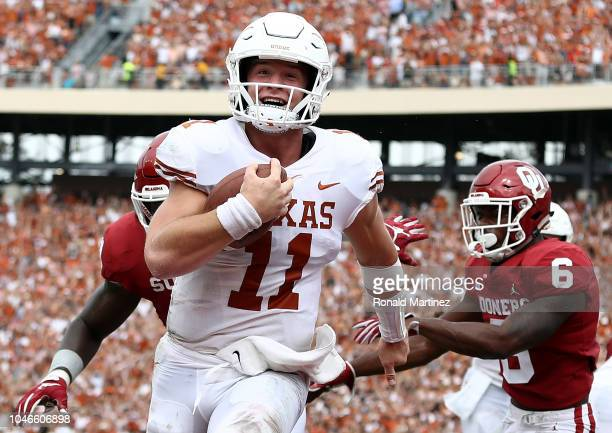 Sam Ehlinger of the Texas Longhorns smiles as he runs into the endzone for a touchdown against the Oklahoma Sooners in the second quarter of the 2018...