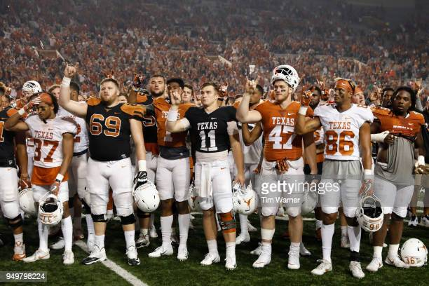 Sam Ehlinger of the Texas Longhorns stands with teammates for The Eyes of Texas after the OrangeWhite Spring Game at Darrell K RoyalTexas Memorial...