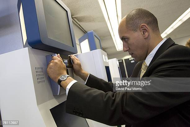 Sam Elgord has his irises scanned as he demonstrates Clear a new security program at the San Francisco International Airport on August 15 2007 in San...