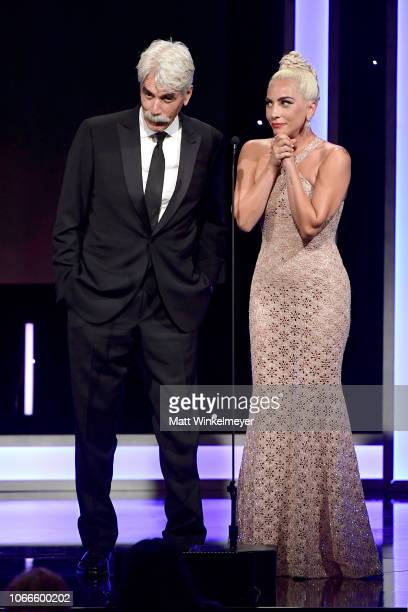 Sam Elliott and Lady Gaga speak onstage during the 32nd American Cinematheque Award Presentation honoring Bradley Cooper at The Beverly Hilton Hotel...