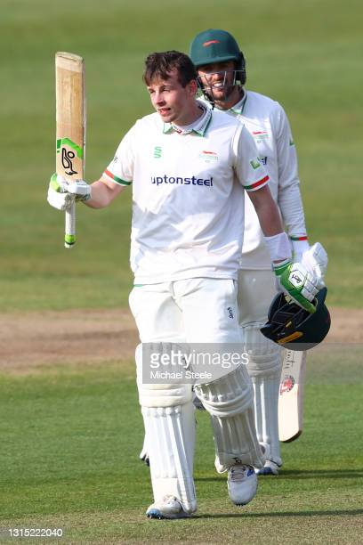 Sam Evans of Leicestershire celebrates reaching his century alongside Lewis Hill during day one of the Group Two LV Insurance County Championship...