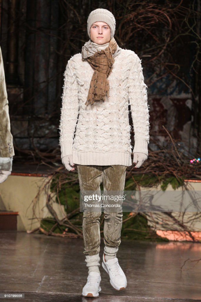 Sam Evans walks the runway wearing John Varvatos Fall/Winter 2018 with makeup by Chika Chan for Make-Up Pro and Hair by Yannik D'Is for Cultler/Redken at the Angel Orensanz Foundation on January 26, 2018 in New York City.