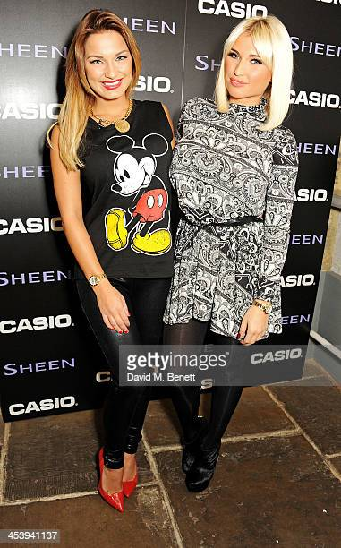 Sam Faiers and Billie Faiers attend the Casio Sheen TOWIE takeover at at the Casio Covent Garden store on December 6 2013 in London England