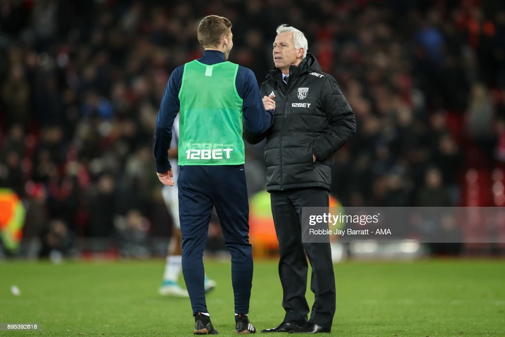 Sam Field of West Bromwich Albion and Alan Pardew of West Bromwich Albion during the Premier League match between Liverpool and West Bromwich Albion at Anfield on December 13, 2017 in Liverpool, England.
