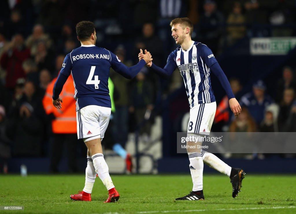 Sam Field of West Bromwich Albion (R) celebrates with Hal Robson-Kanu as he scores their second goal during the Premier League match between West Bromwich Albion and Newcastle United at The Hawthorns on November 28, 2017 in West Bromwich, England.