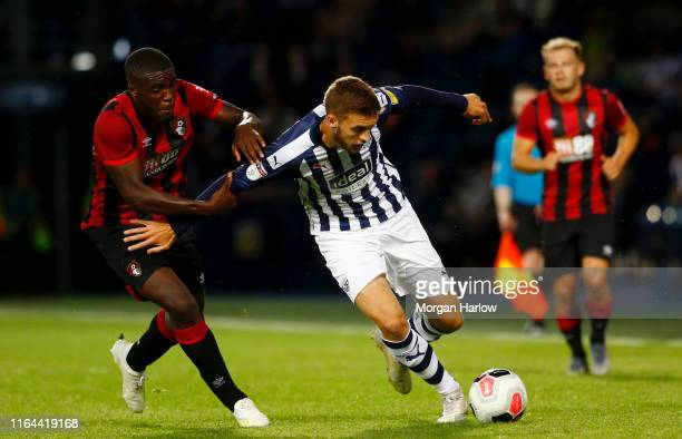 Sam Field West Bromwich Albion is challenged by NNamdi Ofoborh of Bournemouth during the PreSeason Friendly match between West Bromwich Albion and...