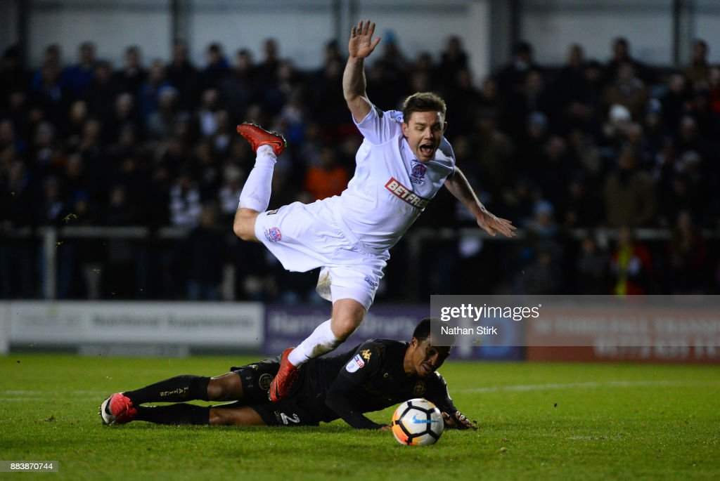 Sam Finley of AFC Fylde is awarded a penalty after Nathan Byrne of Wigan Athletic miss times his tackle during The Emirates FA Cup Second Round match between AFC Fylde and Wigan Athletic on December 1, 2017 in Kirkham, England.
