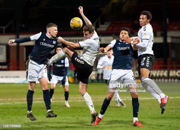 Sam Fisher, Aaron Muirhead, Osman Sow and Corrie Ndaba in action during the Scottish Championship match between Dundee and Ayr United at the Kilmac...