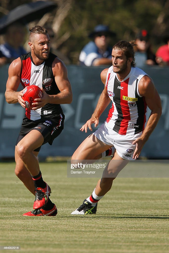 Sam Fisher evades Josh Bruce of the Saints during the St Kilda Saints AFL intra club match at Linen House Oval on February 21, 2015 in Melbourne, Australia.