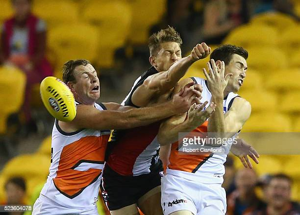 Sam Fisher of the Saints is challenged by Steve Johnson and Jeremy Cameron of the Giants during the round five AFL match between the St Kilda Saints...
