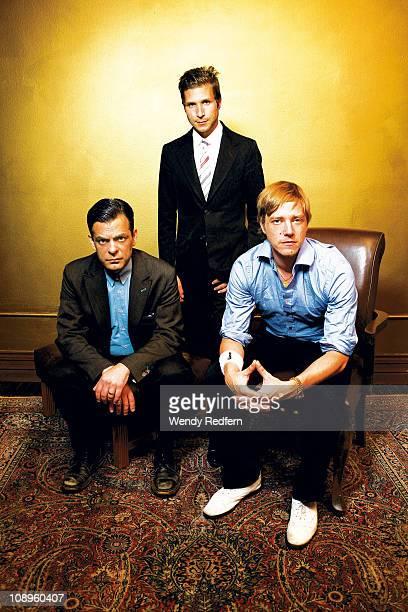 Sam Fogarino Daniel Kessler and Paul Banks of Interpol pose for a studio group portrait on 13th September 2010 in Los Angeles California United States