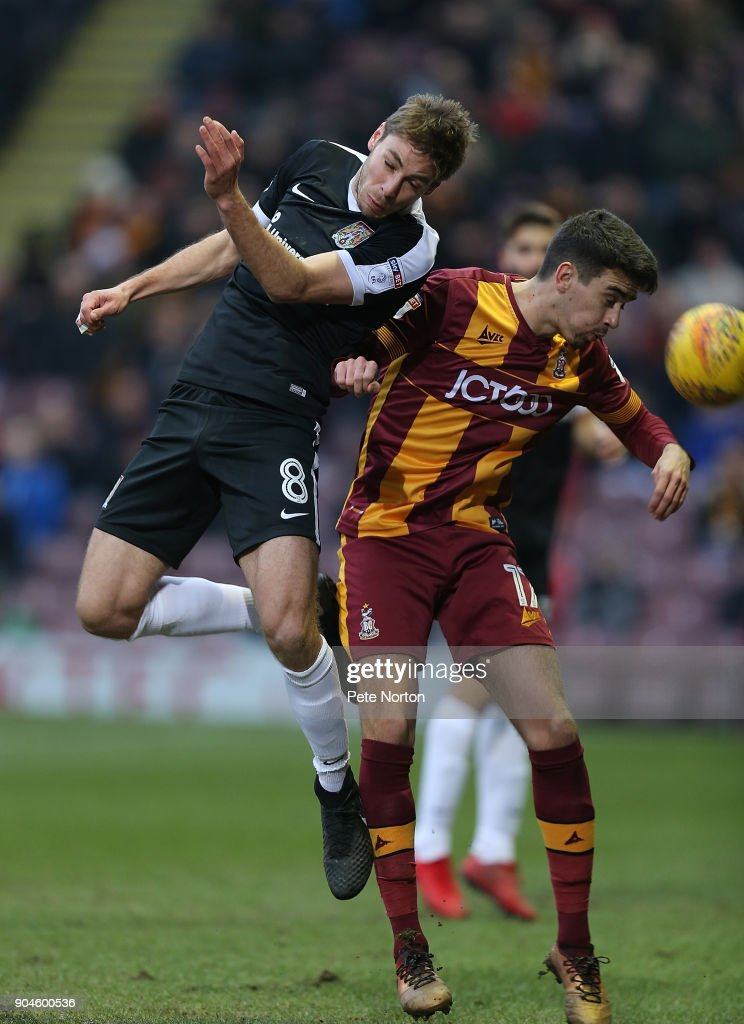 Sam Foley of Northampton Town contests the ball with Alex Gilliead of Bradford City during the Sky Bet League One match between Bradford City and Northampton Town at Northern Commercials Stadium, Valley Parade on January 13, 2018 in Bradford, England.