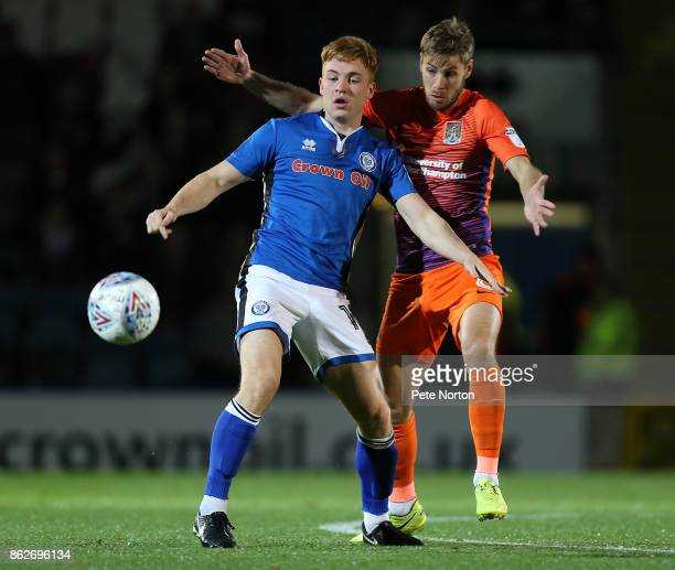 Sam Foley of Northampton Town contests the ball with Callum Camps of Rochdale during the Sky Bet League One match between Rochdale and Northampton...