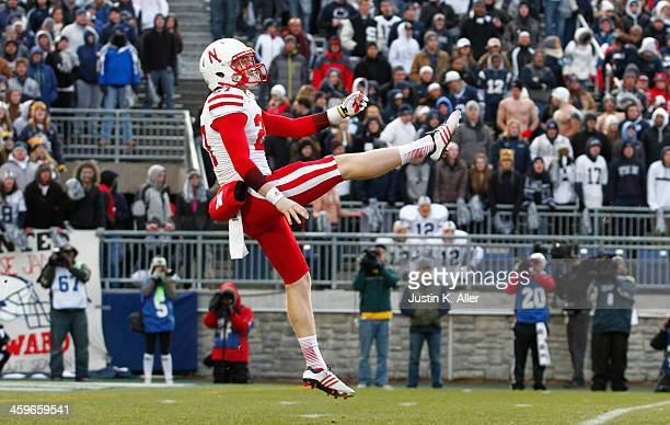 Sam Foltz of the Nebraska Cornhuskers punts against the Penn State Nittany Lions during the game on November 23 2013 at Beaver Stadium in State...