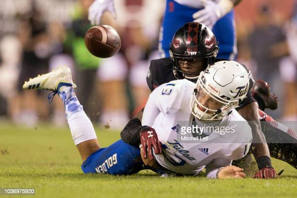 Sam Franklin of the Temple Owls forces a fumble on Luke Skipper of the Tulsa Golden Hurricane in the fourth quarter at Lincoln Financial Field on...