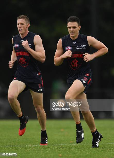 Sam Frost and Jake Lever of the Demons do sprints during a Melbourne Demons AFL training session at Gosch's Paddock on December 1 2017 in Melbourne...
