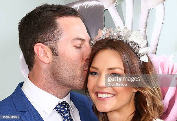 Sam Frost and Sasha Mielczarek from The Bachelorette Australia finale kiss at the Myer Marquee on Melbourne Cup Day at Flemington Racecourse on...