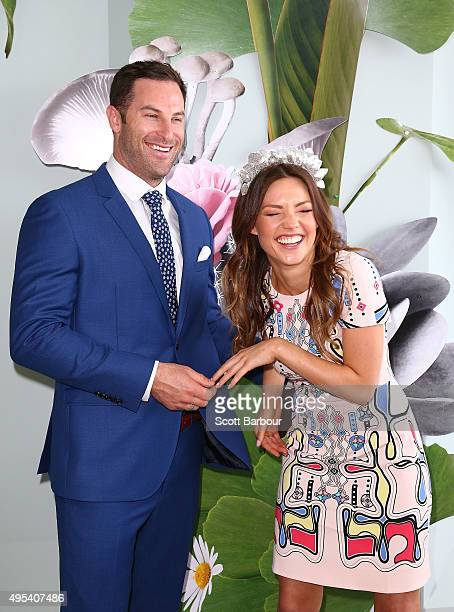 Sam Frost and Sasha Mielczarek from The Bachelorette Australia finale laugh at the Myer Marquee on Melbourne Cup Day at Flemington Racecourse on...
