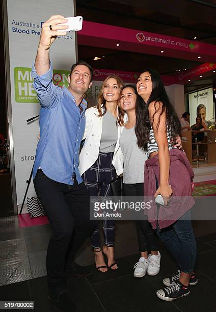 Sam Frost and Sasha Mielczarek pose for a selfie with fans at the launch of Australia's Biggest Blood Pressure Check on April 8 2016 in Sydney...