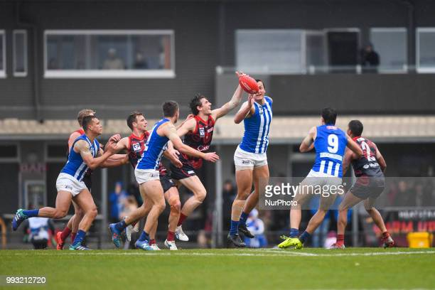 Sam Frost of the Casey Demons and Braydon Preuss of North Melbourne battle in the ruck during the VFL round 14 game between the Casey Demons and...